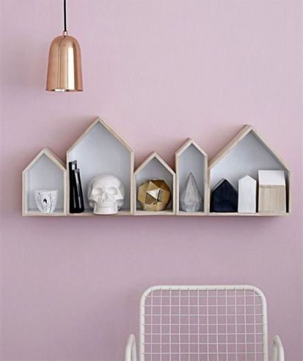 Pale-pink-copper-geometric-shapes-skulls-and-minimalist-black-white-and-wooden-house-spade-shelves.